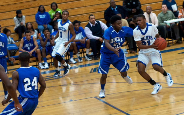 Cam Morse (foreground) and Denzel Watts (background), command the backcourt of our second-ranked Flint-area high school boys basketball team.