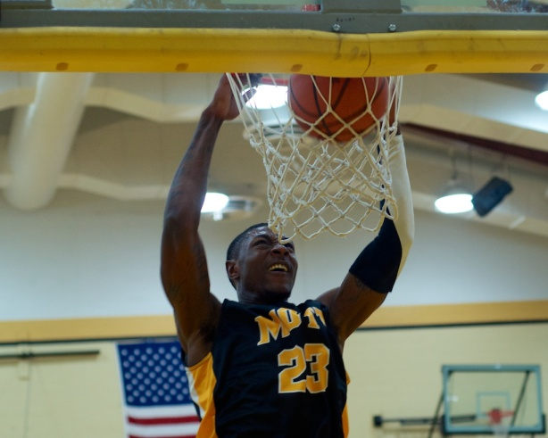 Sophomore Fred Mattison slams home two of his game-high 20 points for Mott.