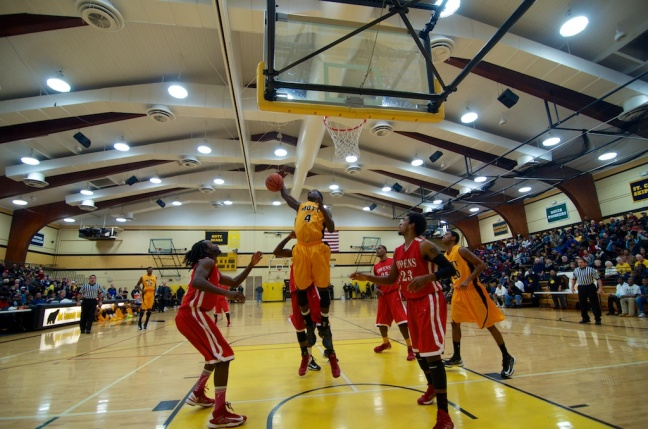 Mott sophomore Kortez Ross soars for a rebound in the first half of the Bears' 76-68 win over Owens Thursday night.