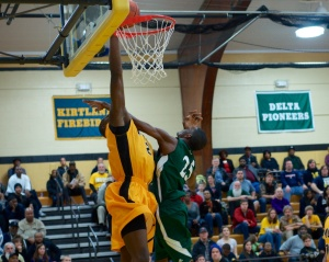 Freshman Coreontae DeBerry slams home two of his seven points against Oakland. A foul was not called.