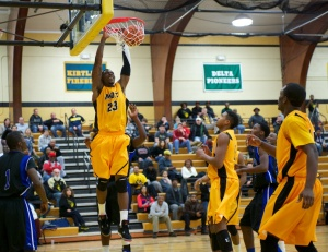Mott sophomore Fred Mattison slams home two of his 17 points.