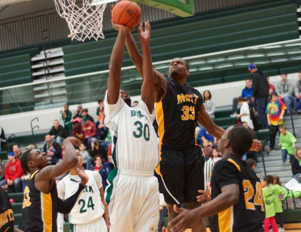 Mott freshman Travon Banks blocks Delta's Tre Johnson in the first half of Mott's 78-50 win.
