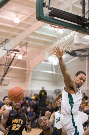 Mott sophomore Kory Billups has his shot blocked by Oakland's James Chappell.