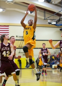 Mott's Devin Foster drives to the basket against Alpena Thursday night.