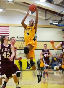 Mott's Devin Foster drives to the basket against Alpena Thursday night.