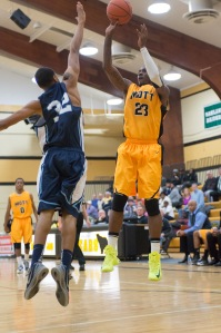 Sophomore forward Fred Mattison scores two of his 16 points on Wednesday night.