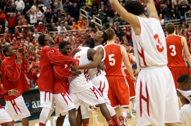 Flint Beecher players celebrate as the final buzzers sounds after their 40-39 victory over Laingsburg in the Class C State Championship game in East Lansing.