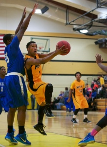 Mott freshman Justice Green scores two of his game-high 17 points Wednesday night in a win over Wayne County. (Gerry Leslie photo)