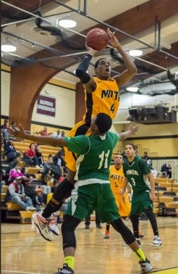 Mott freshman Daryl Bigham goes for two against Delta College Saturday afternoon. (Gerry Leslie photo)