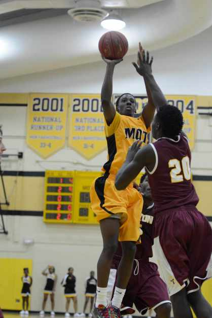 Mott sophomore Lorenzo Collier soars for a score in the second half against Triton. (Mike Tews photo)
