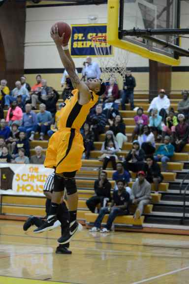 Mott freshman Jalen Fykes throws down a reverse dunk in the first half Wednesday night.